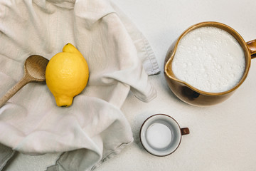 Cheese making recipe ingredients, milk, lemon and a cotton cloth