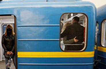 A couple share a kiss inside a train in Kiev