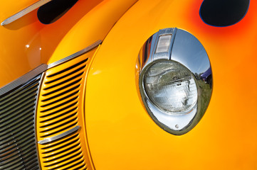 Wall Mural - retro vehicle grill abstract in sunset shades of yellow and orange
