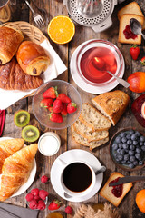 continental breakfast with coffee, tea, croissant and fresh fruit