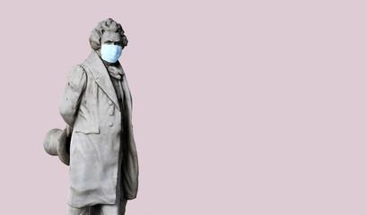 Ancient human statue wearing face mask against coronavirus COVID-19
