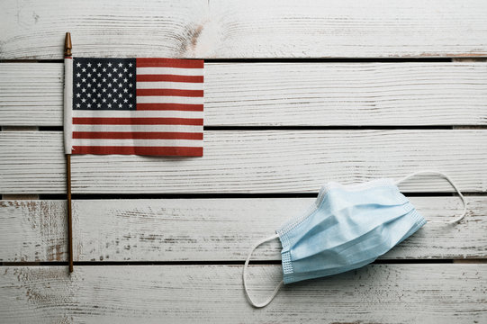 American stars and stripes flat lay over rustic wood background 4th of July memorial day in Americana style