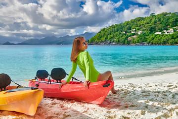 Wall Mural - Woman sitting on kayak at beach, Seychelles, Mahe
