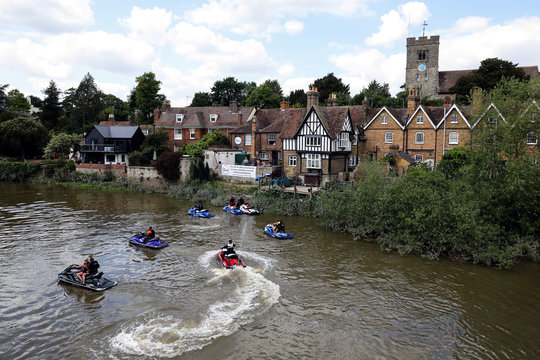 People ride on jet skis on the River Medway