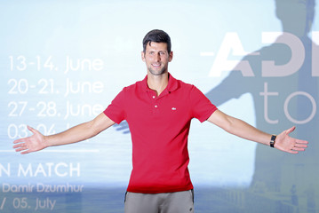 World number one tennis player Novak Djokovic poses after a news conference, in Belgrade