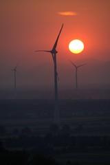 Foto auf Gartenposter Ziegel Windmills On Landscape Against Sky During Sunset