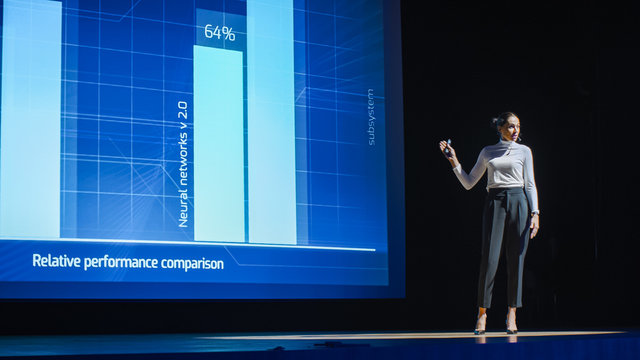 Tech Conference Stage: Visionary Female Speaker Talks about Product. Neural Networks, Artificial Intelligence, Big Data and Machine Learning. Infographics On Big Screen. Live Startup Business Event