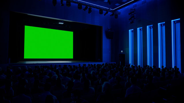 In Movie Theater Captivated Audience Watching New Blockbuster Film on Mock-up Green Screen. People Watching Video Game Tournament Streaming, Concert Video, Product Release Trailer.