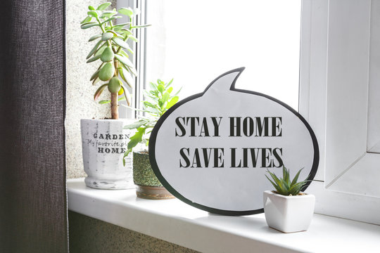 Coronavirus covid.19. Stay at home Self-quarantine Text message with coronavirus COVID-19 Coronavirus to inform social distance. COVID-19 staying at home window background.�Stay home, save a life�