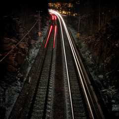 High Angle View Of Light Trails At Railroad Tracks