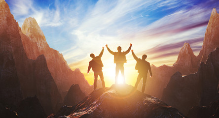 Silhouette of a team of three people celebrating victory against the backdrop of mountains and sunset. 3d rendering