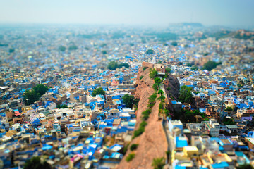 Aerial view of Jodhpur, also known as Blue City due to the vivid blue-painted Brahmin houses around Mehrangarh Fort. Jodphur, Rajasthan. Tilt shift miniature toy camera effect