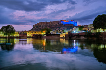 Famous indian tourist landmark Mehrangarh fort in the evening view over Gulab Sagar lake. Jodhpur, Rajasthan, India