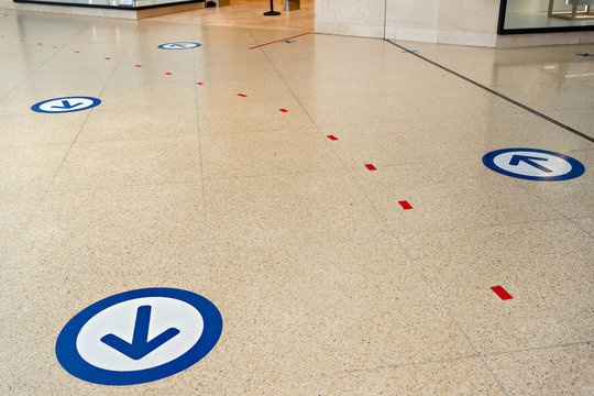 Epidemic protection measures in shops or shopping malls - two way direction for customers. Social Distance Shopping Line Up.  Life after virus. Secure marking of lines on floor for waiting in store.