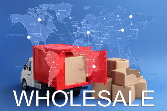 Wholesale business. World map and truck model with carton boxes on background