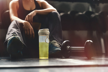 Foto auf Acrylglas Fitness woman having relax after workout and excercise in gym and fitness club with roll of dumbells on rack, healthy sports woman lifestyle