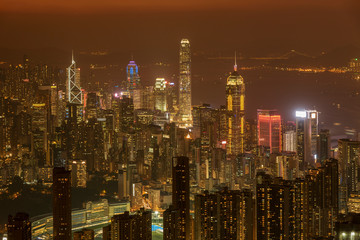 Fototapete - Downtown of Hong Kong city at dusk