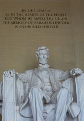 Washington DC, USA - 22 Dec 2019: Inside the Abraham Lincoln Memorial; Statue with Quote above