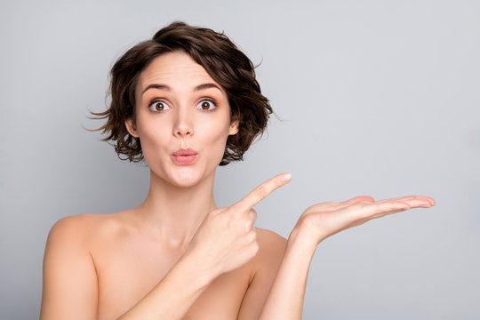 Closeup photo of beautiful naked lady bob short hairdo showing new spa salon procedure on open arm direct finger shocked isolated grey color background