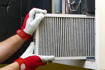 Replacing the filter in the central ventilation system. Replacing Dirty Air filter for home central air conditioning system. Change filter in rotary heat exchanger recuperator.