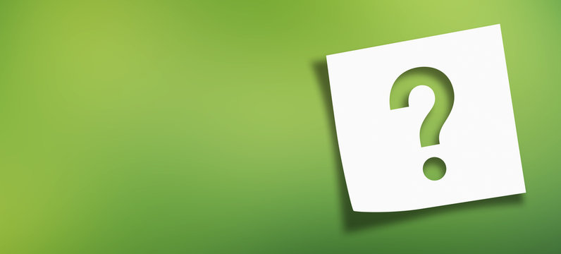 Note paper with question mark on panoramic abstract green background