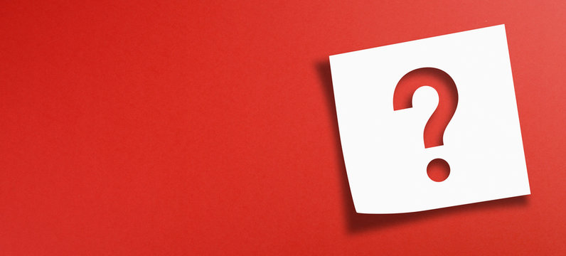 Note paper with question mark on panoramic red background