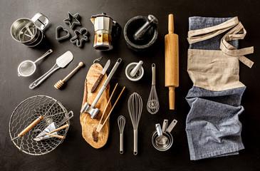 Kitchen utensils (cooking tools) on black chalkboard background