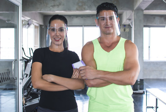 Man and woman wearing face shield to protect virus before doing exercise