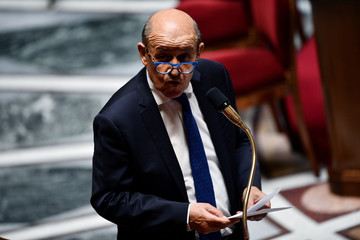 French Foreign Affairs Minister Jean-Yves Le Drian speaks during a session of questions to the Government at the French National Assembly in Paris