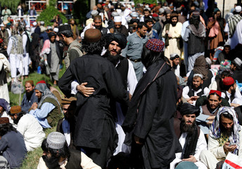 Newly freed Taliban prisoners greet each other at Pul-i-Charkhi prison, in Kabul, Afghanistan