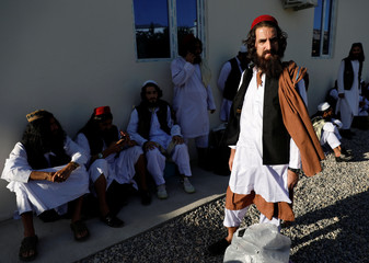 A newly freed Taliban prisoner stands at Pul-i-Charkhi prison, in Kabul, Afghanistan