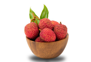 Fototapete - Pile of ripe lychees in a wooden bowl on white background with clipping path
