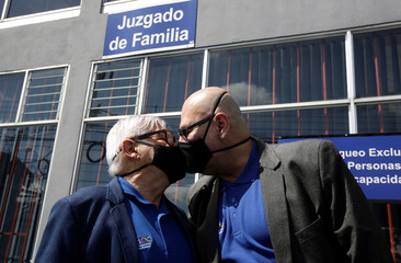 Marcos Castillo and his partner Rodrigo Campos kiss following their marriage ceremony, after Costa Rica legalised same-sex marriage, in San Jose