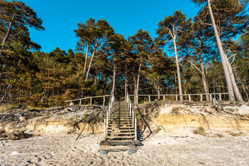 Fototapeta Wooden stairs the beach of Baltic sea t near place called
