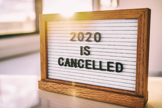 COVID-19 Coronavirus Quote 2020 IS CANCELLED written on white felt letter board sign. Funny message for public events, outdoor gatherings.