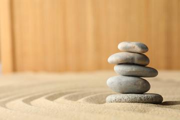 Photo sur Toile Zen pierres a sable Stones on the sand with patterns. Zen concept