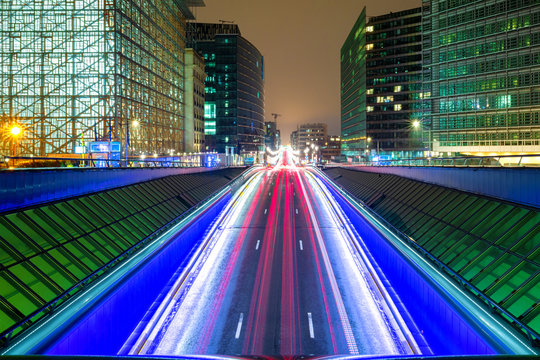 Light trails through city streets at night, Brussels, Belgium