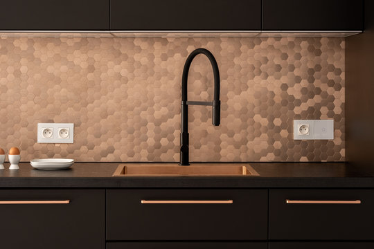 Elegant kitchen in black and gold