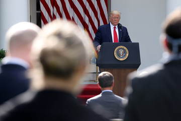U.S. President Trump listens to questions from reporters after speaking about negotiations with pharmaceutical companies over the cost of insulin, at the White House in Washington