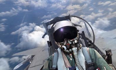 Fototapeta Jet fighter pilot flying over cloudy sky with motion blur obraz