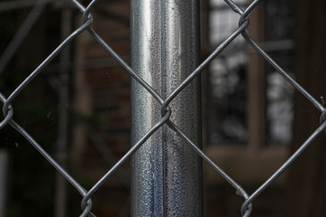 Close-up of a chain link fence with metal fence