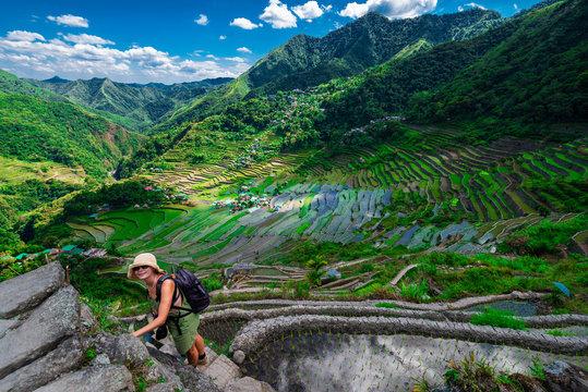 Tourist during trekingu on ancient old Batad Rice Terraces, Philipines, Southeast Asia