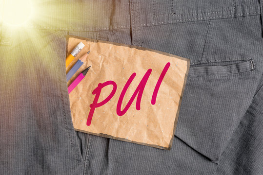 Handwriting text writing Pui. Conceptual photo an individual that has acute respiratory distress syndrome based on evidence Writing equipment and brown note paper inside pocket of man work trousers