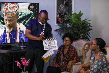 Film director Samuel Idiagbonya marks the slate during the production of Meadow series, following the relaxation of lockdown, amid the coronavirus disease (COVID-19) outbreak in Abuja