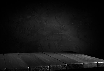 Wall Mural - Wooden table with dark blurred background design