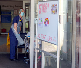 A triage nurse waits for patients in the Emergency Department at Frimley Park Hospital in Surrey