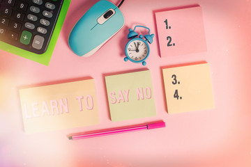Handwriting text Learn To Say No. Conceptual photo decline or refuse few things before you destroy yourself Notepads mouse alarm clock calculator sheet marker colored background