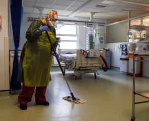 A woman works in an Intensive Care ward at Frimley Park Hospital in Surrey