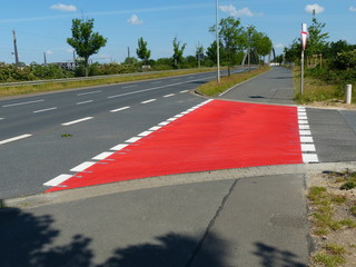 Foto op Aluminium F1 A well-marked bike path at an intersection increases safety for all road users. Hanover, Stöcken, Germany.