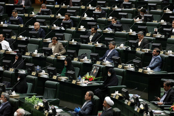 Iranian lawmakers attend the opening ceremony of Iran's 11th parliament, practicing social distancing as the spread of the coronavirus disease (COVID-19) continues, in Tehran